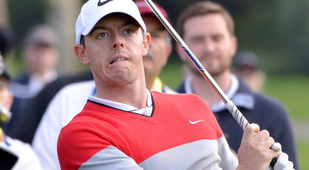 New technique: Rory McIlroy will putt with his left hand below his right in an attempt to banish his woes on the green