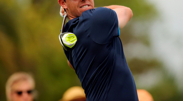 Eyes on prize: Rory McIlroy tees off at the 11th hole during last night's first round of the WGC-Cadillac Championship at Trump National Doral in Florida