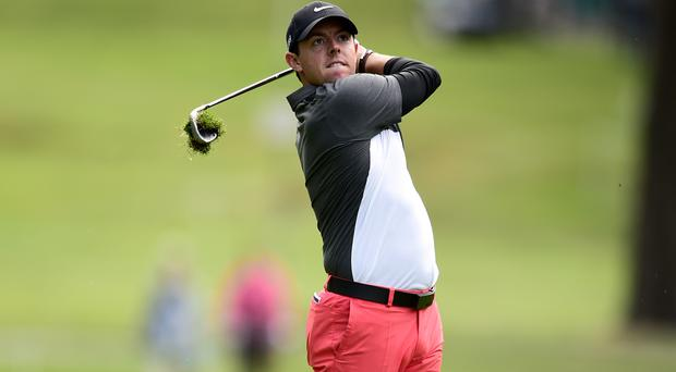 Rory McIlroy advanced to the last 16 on Friday