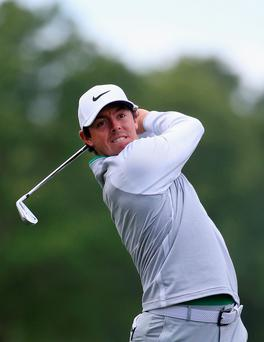 On the charge: Rory McIlroy hits form during last night's second round