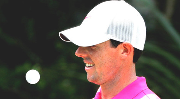 Juggling act: Rory McIlroy relaxes during last night's final round at Sawgrass