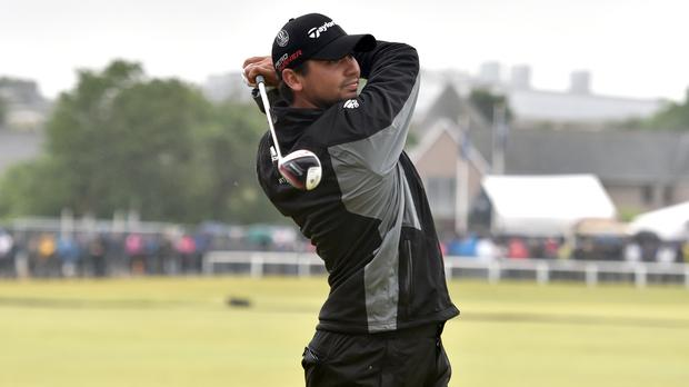 World number one Jason Day retained a share of the lead at the WGC-Bridgestone Invitational in Ohio