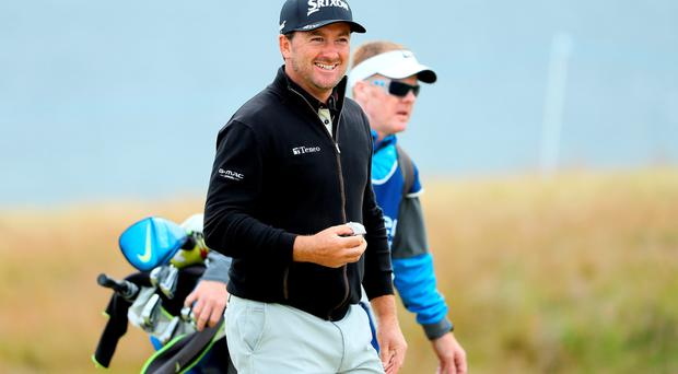 On course: Graeme McDowell on his way to a three-under-par 69 in the Scottish Open second round at Castle Stuart