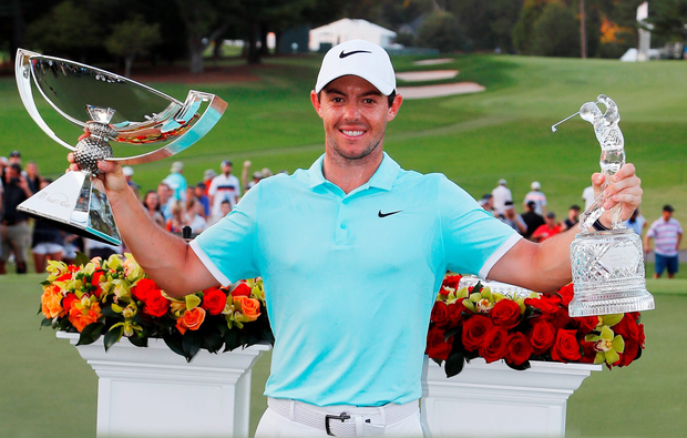 Rory glory: McIlroy with the Tour Championship and FedEx Cup trophies
