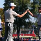 Europe's Thomas Pieters and Rory McIlroy, right, celebrate