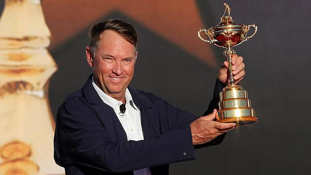 United States captain Davis Love lifts the Ryder Cup