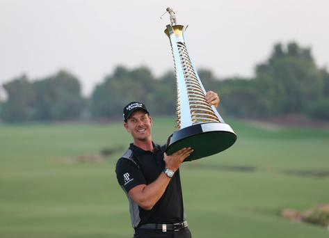 Out in front: Henrik Stenson poses after winning the Race to Dubai title