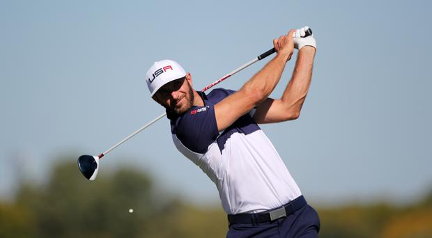 Dustin Johnson recorded a flawless 64 to set the early target in Abu Dhabi