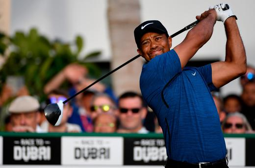 Tiger Woods out of Dubai Desert Classic with 'bad back'