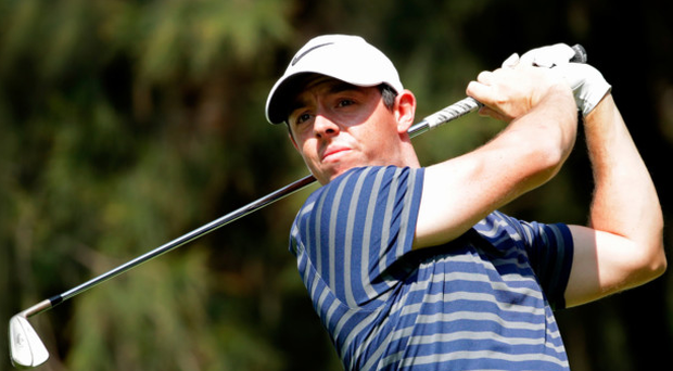 Leading man: Rory McIlroy plays his tee shot on the ninth hole on his way to a stunning 65, and the lead, during last night's second round of the World Golf Championships in Mexico City