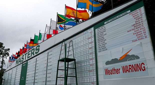 Disrupted: Play at Augusta was interrupted for two hours by bad weather before further storms led to practice being suspended for the day