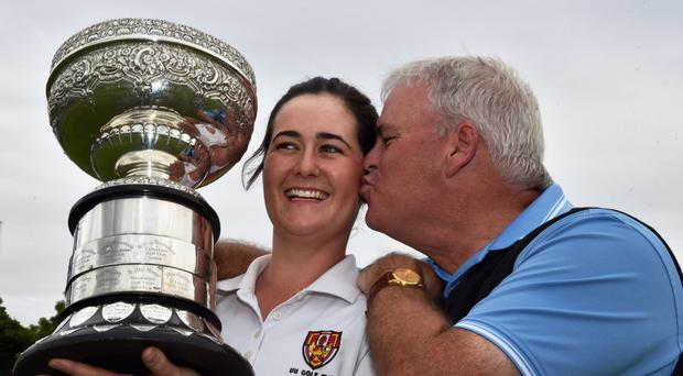 Paula Grant (Lisburn) received a kiss from her caddy father Paul