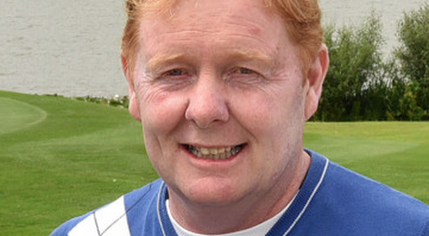 Cup of cheer: Jim Carvill after his title triumph at Malone
