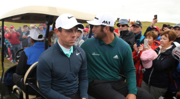 Driven off: Rory McIlroy is dejected after missing the cut