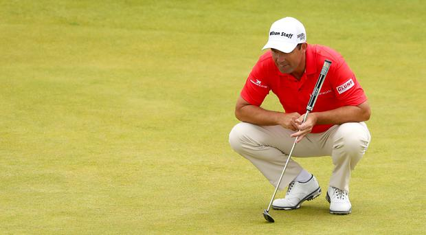 Ireland's Padraig Harrington set the clubhouse target on day two of the Aberdeen Asset Management Scottish Open