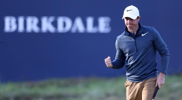 Rory McIlroy is ready to get his Open challenge back on track in windier conditions on the second day.