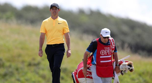Rory McIlroy, pictured left, has confirmed his split from caddie JP Fitzgerald, right