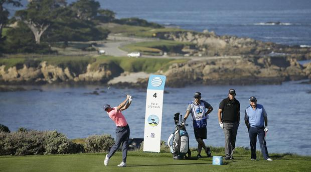 Rory McIlroy hits from the fourth tee of the Spyglass Hill Golf Course (AP Photo/Eric Risberg)