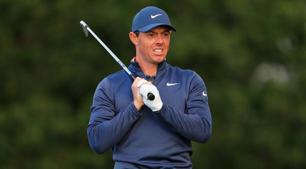 Tough round: Rory McIlroy after hitting a poor shot yesterday
