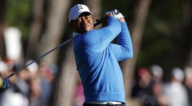 Tiger Woods stayed in contention early in the third round at the Valspar Championship