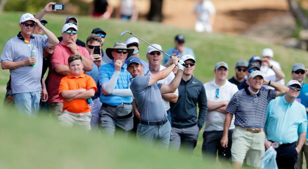 Eyes on prize: Rory McIlroy at the second hole during last night's World Golf Championships-Dell Match Play at Austin Country Club