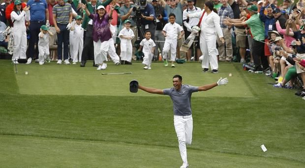 Tony Finau celebrated before going over on his ankle