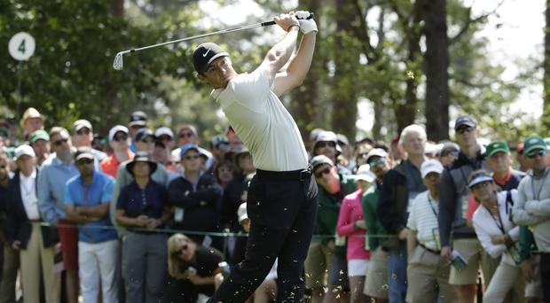 Rory McIlroy shares early clubhouse lead on day two at the Masters