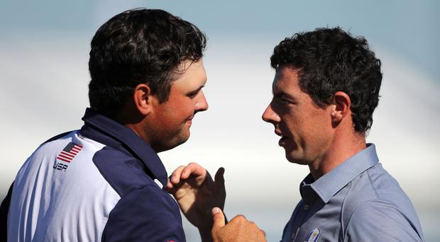 Rory McIlroy (right) and Patrick Reed provided the headline match in the 2016 Ryder Cup singles. Now they're the final pairing of the 2018 Masters.