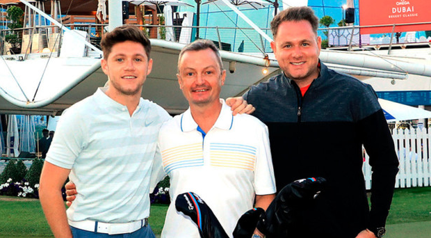 Good support: Niall Horan (left) with Modest! Golf colleagues Ian Watts (centre) and Mark McDonnell at the Dubai Desert Classic earlier this year where several of their players took part