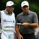 Francesco Molinari, right, held on to win the BMW PGA Championship