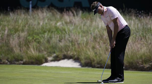 Ian Poulter shares the clubhouse lead (Seth Wenig/AP)