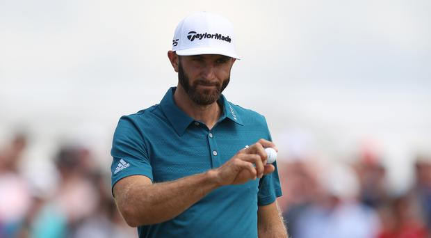 Dustin Johnson will take a four-shot lead into the third round of the US Open (Andrew Matthews/PA)