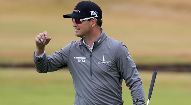 Zach Johnson holds the clubhouse lead at six under (Richard Sellers/PA)