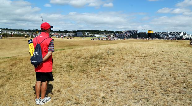 A course marshal looks down the first fairway at Carnoustie (Richard Sellers/PA)