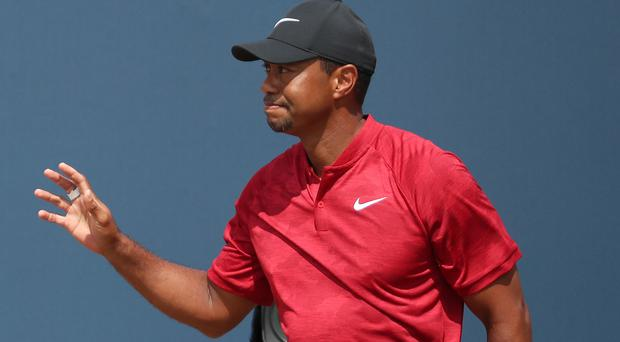 Tiger Woods frustrated after fan yells during his tee shot