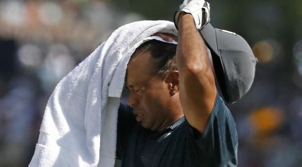 Tiger Woods carded an opening 70 in the US PGA Championship (Brynn Anderson/AP)
