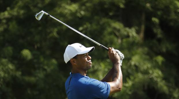 Tiger Woods is vying for his first major title in a decade (PA)