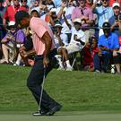 Tiger Woods impressed in front of a large crowd (John Amis/AP)