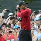 Tiger Woods completed his first win in five years (John Amis/AP)