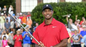 Tiger Woods holds Calamity Jane, the official trophy of the tournament (John Amis/AP)