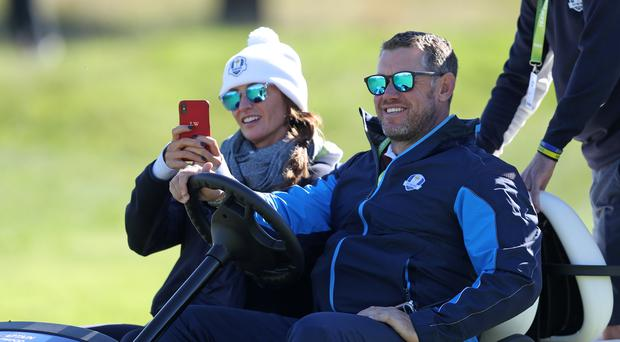 Lee Westwood and partner Helen Storey enjoyed an emotional win in Sun City (David Davies/PA)