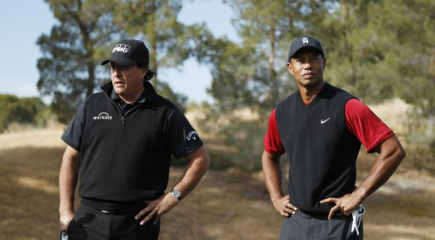 Phil Mickelson, left, beat Tiger Woods on the 22nd hole of their match in Las Vegas (John Locher/AP)