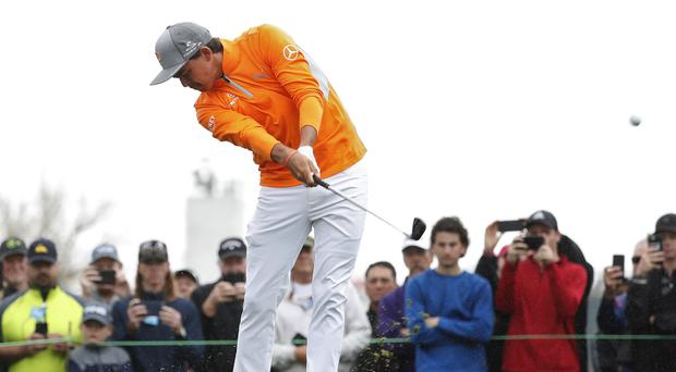 Rickie Fowler in his famous orange clothing.