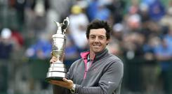 Northern Ireland's Rory McIlroy with the Claret Jug after winning the 2014 Open Championship at Royal Liverpool Golf Club (Owen Humphreys/PA)