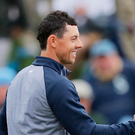 On top: Rory McIlroy celebrates with caddie Harry Diamond after winning the Players Championship