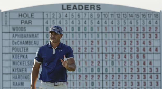 Brooks Koepka holds a share of the lead after day one of the 83rd Masters (AP Photo/Charlie Riedel)