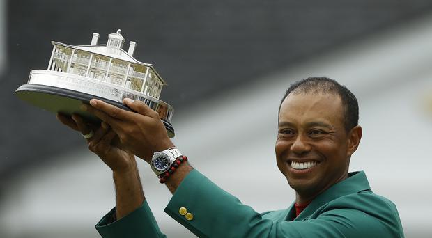 Tiger Woods sealed a thrilling Masters victory to complete one of sport's greatest comebacks (Matt Slocum/AP)