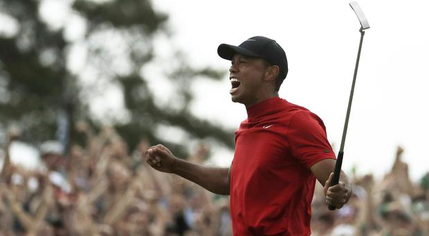 Tiger Woods celebrates winning the Masters (Charlie Riedel/AP)