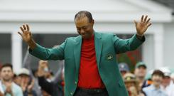 Tiger Woods celebrates after donning the green jacket at Augusta (Matt Slocum/AP)