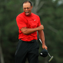 Pure emotion: A delighted Tiger Woods after winning his fifth Masters title on Sunday at Augusta